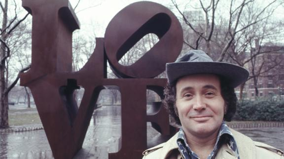 Robert Indiana with his 'LOVE' sculpture in Central Park, New York City in 1971