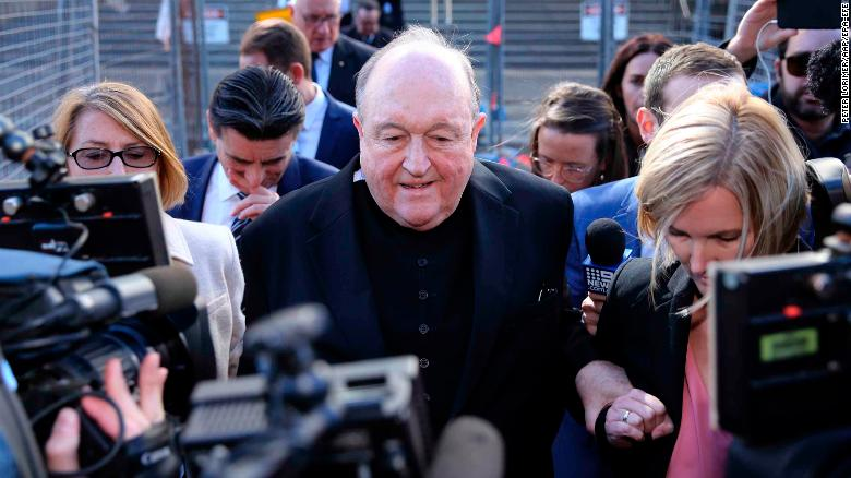 Archbishop Philip Wilson (center) leaves the Newcastle Local Court in Newcastle, New South Wales, Australia, on 22 May 2018.