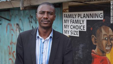 Wilson Bunde stands outside the FHOK clinic in Kibera, where women once received free contraceptives.