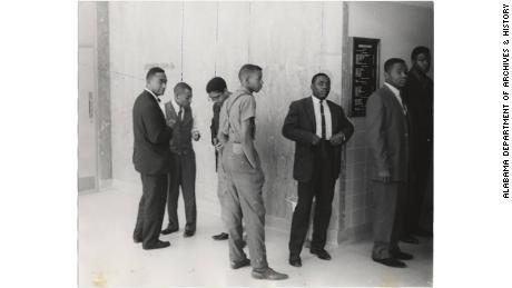 Dr. Lawrence Dunbar Reddick, St. John Dixon, Edward English, and four other students from Alabama State University, who participated in a civil rights demonstration at the lunchroom of the Montgomery County Courthouse.