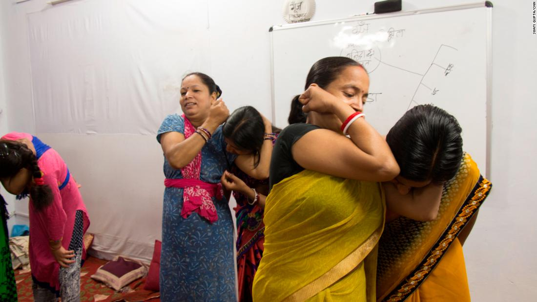 Trainers from the Delhi Police teach women how to fight an attacker if he approaches from behind.