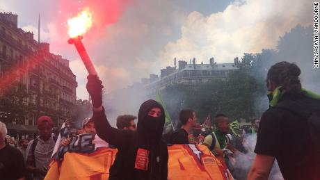 Marchers wave flares at the Place de la République in Paris during nationwide strikes on Tuesday.