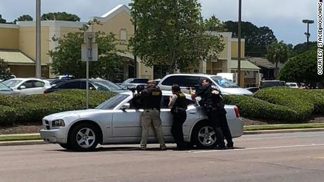 Authorities have drawn weapons on a photo by Stacie Houchins.