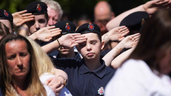 A cadet salutes during a minute's during the outside broadcast of the Manchester Arena commemoration.