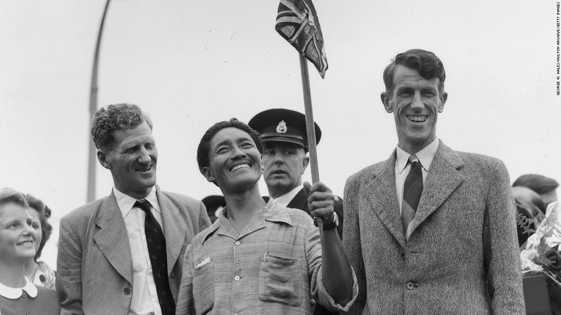 "Tenzing Norgay (C), better known as Sherpa Tensing, and Edmund Hillary (R) were the <a href=""http://www.guinnessworldrecords.com/world-records/first-ascent-of-mount-everest"" target=""_blank"">first to complete a successful ascent</a> to the top of the world in May 1953."