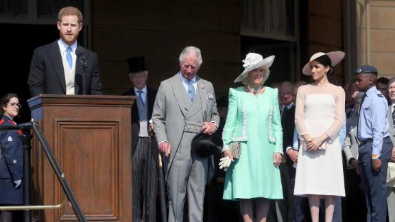 Harry gives a speech next to Prince Charles, Charles