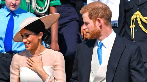 Meghan, the Duchess of Sussex gestures as she walks with her husband, Prince Harry, as they attend a garden party at Buckingham Palace in London, Tuesday May 22, 2018, their first royal engagement since their wedding on Saturday. The event is part of the celebrations to mark the 70th birthday of Prince Charles.  (Dominic Lipinski/Pool Photo via AP)