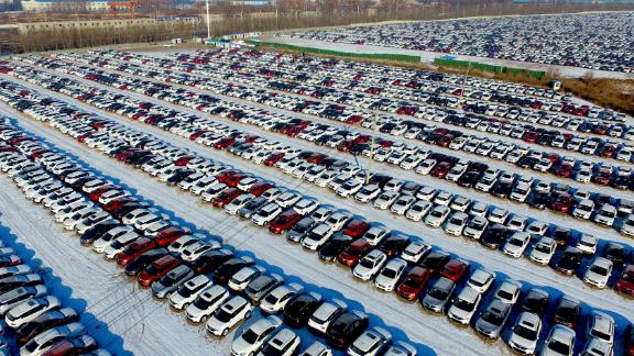 This aerial photo taken on January 16, 2017 shows new cars lined up at a parking lot in Shenyang, northeast China