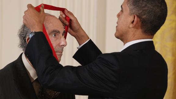 President Barack Obama presents the 2010 National Humanities Medal to Philip Roth at the White House.