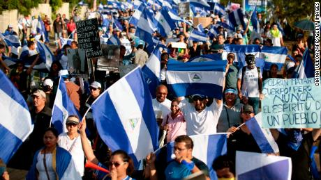 "People take part in a march marking a month since the beginning of protests against the government in Managua on May 18, 2018. - The Inter-American Commission on Human Rights on Friday called for Nicaragua's government to ""immediately halt the repression of protests"" against President Daniel Ortega, as the death toll rose to 63. (Photo by DIANA ULLOA / AFP)        (Photo credit should read DIANA ULLOA/AFP/Getty Images)"