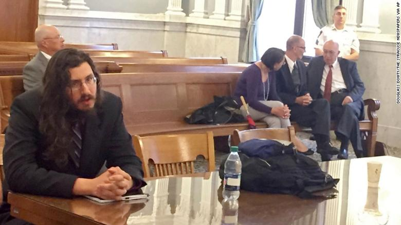 Michael Rotondo (left) at his eviction proceeding in Syracuse, New York. His parents, Mark and Christina, confer with their lawyer in the court gallery behind.