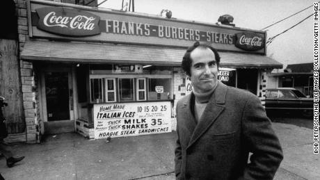 Author, Philip Roth, revisiting areas where he grew up in Newark, standing at hamburger stand.  (Photo by Bob Peterson/The LIFE Images Collection/Getty Images)