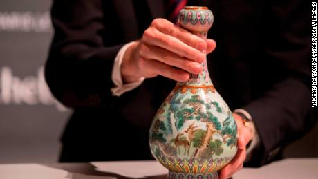 A rare Imperial Qianlong porcelain vase (18th century) is displayed at Sotheby's auction company in Paris, on May 22, 2018. - The vase, which was stored in a shoebox in an attic for decades, will be sold at Sotheby's Paris on June. (Photo by Thomas SAMSON / AFP)        (Photo credit should read THOMAS SAMSON/AFP/Getty Images)