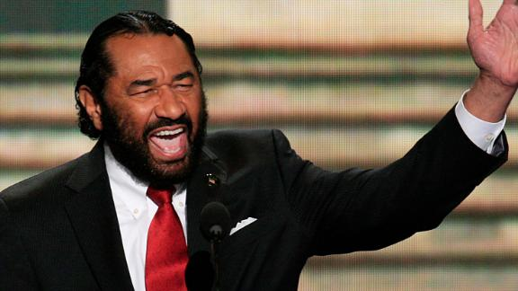 Representative Al Green, a Democrat from Texas, gestures while speaking during day two of the Democratic National Convention (DNC) in Charlotte, North Carolina, U.S., on Wednesday, Sept. 5, 2012. Democratic officials have moved President Barack Obama's nomination acceptance speech tomorrow night to the Time Warner Cable Arena from the larger, outdoor Bank of America Stadium because of the possibility of severe weather. Photographer: Scott Eells/Bloomberg via Getty Images