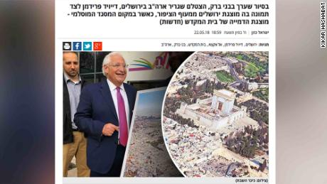 David Friedman photographed beside a controversial photo illustration of Jerusalem, as seen on the website of Kikar Hashabat.