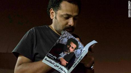 "Prominent activist and blogger Wael Abbas signs a copy of his book, ""The Theory of Leaving the Bowl,"" in Cairo."