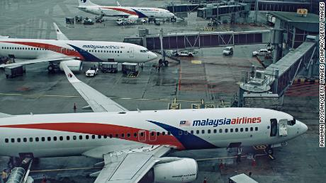 KUALA LUMPUR, MALAYSIA - JANUARY 23: Malaysian Airlines aircrafts are seen at the busy terminal of Kuala Lumpur International airport on January 23, 2017 in Sepang, Malaysia. The families of victims onboard the missing flight MH370 said on Sunday they plan to hand deliver a petition and personal letters to Malaysian Transport Minister, Liow Tiong Lai, during his visit to Australia, urging him to resume search for the missing plane after authorities recently announced the international search is suspended. The reputation of Malaysian Airlines remained stained by the flight that went missing in March 2014 while traveling from Kuala Lumpur to Beijing with 239 passengers aboard, 154 were Chinese. (Photo by Rahman Roslan/Getty Images)