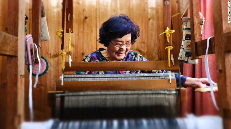 Natsuko Maenaka, 84, still weaves and tries to learn new things to stave off dementia.