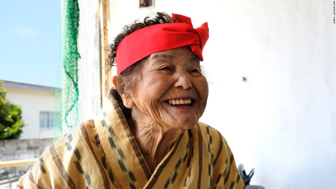 Centenarian Haru Yamashiro has trouble hearing but still moves quickly from place to place.