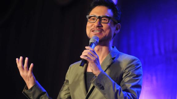 Hong Kong singer Jacky Cheung performs during a live concert to promote his new album in Taipei on July 21, 2013.  Cheung