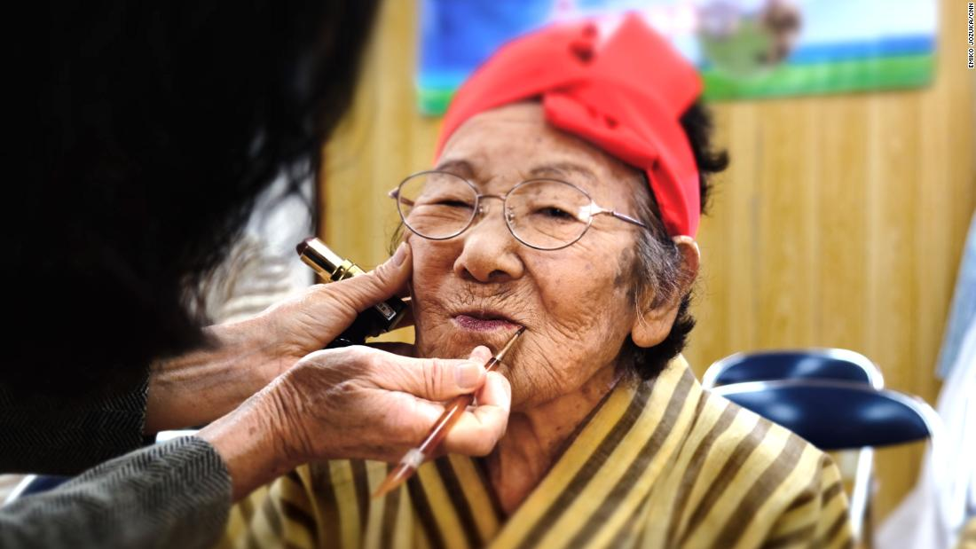 Tomi Menaka, 95, has her makeup done before a KBG48 rehearsal.