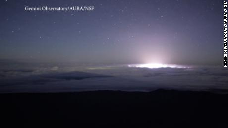 A camera used at the Gemini North telescope to monitor sky conditions from Hawaii's Maunakea captured a remarkable time-lapse sequence of the Kīlauea volcanic eruption. The sequence shows the glow from an extensive region of fissures over the course of a single night (May 21-22). During the sequence, multiple fissures expelled lava in the area in and around Leilani Estates in the Puna district of the Big Island of Hawai'i. The lava also flowed into the ocean during the period of the video.  The camera used for the sequence looks eastward toward the town of Hilo (center), which is mostly obscured by clouds. The moon illuminates the landscape early in the sequence. Later, the setting moon (behind the camera) casts shadows of Gemini and several Maunakea observatories as well as a projection of the mountain onto the atmosphere.  The camera used for the video utilizes a wide-angle lens on a relatively ordinary single lens reflex (SLR) camera with its infrared filter removed. This combination causes the volcanic glow to take on a white/blue hue rather than the familiar red color of the lava.