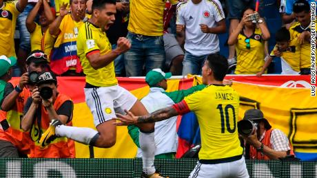 Colombia's Radamel Falcao (L) celebrates with teammate James Rodriguez after scoring against Brazil during their 2018 World Cup football qualifier match, in Barranquilla, Colombia, on September 5, 2017. / AFP PHOTO / Luis ACOSTA        (Photo credit should read LUIS ACOSTA/AFP/Getty Images)