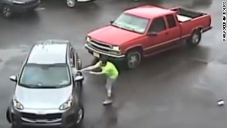 From Philly Police: On May 22, 2018, at 1:33 pm, surveillance video of a possible road rage was recovered on the 2700 block of Luzerne Street. The video depicts two vehicles, vehicle #1 a silver SUV being followed by vehicle #2, a red pickup truck. Once inside the parking lot of a business the driver of the pickup truck blocks the SUV from leaving the lot when an unknown male exits the pickup with a sledge hammer and smashed the drivers side window. After repeatedly hitting the SUV with the sledge hammer the SUV attempts to leave the lot causing its passenger to fall out of the SUV then stops a short distance away. After the passenger of the SUV gets up and attempts to reenter the SUV, the operator of the pickup truck strikes the passenger with the sledge hammer then breaks the rear window out of the SUV. Both vehicles then leave the area in an unknown direction. The victim and offender of this incident is unknown at this time.