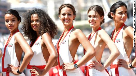 Grid girls pose for photographers after the qualifying session at the Monaco street circuit, on May 27, 2017 in Monaco, ahead of the Monaco Formula 1 Grand Prix.     / AFP PHOTO / ANDREJ ISAKOVIC        (Photo credit should read ANDREJ ISAKOVIC/AFP/Getty Images)