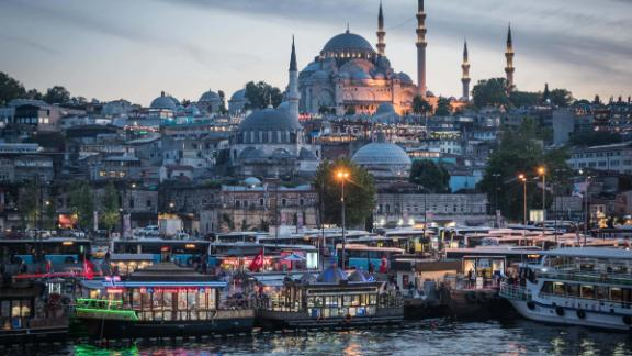 Istanbul: The Süleymaniye Mosque, completed in 1558, rises over the Golden Horn estuary, which is bustling with boats on an evening in May.