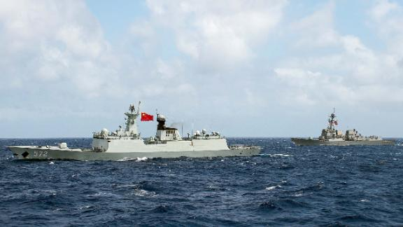 The People's Republic of China Chinese Navy frigate Hengshui and the guided-missile destroyer USS Stockdale transit in formation during RIMPAC 2016.