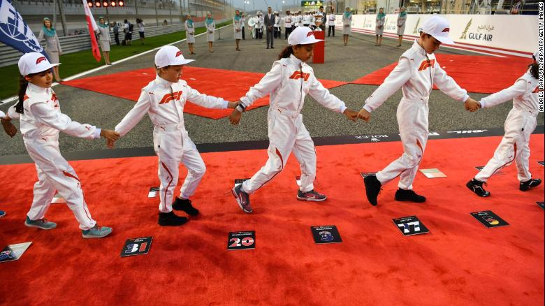 Children walk off the starting grid prior to the Bahrain Formula One Grand Prix on April 8, 2018.