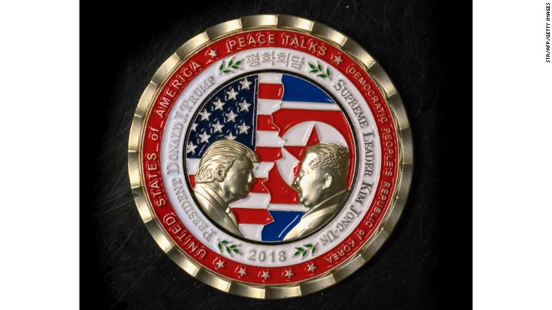 "A commemorative coin featuring US President Donald Trump and North Korea's Kim Jong Un was struck by the White House Communications Agency ahead of their summit meeting, which Trump has cancelled. The coin depicts Trump and Kim, described as North Korea's ""Supreme Leader,"" in profile facing each other in front of a background of US and North Korean flags."