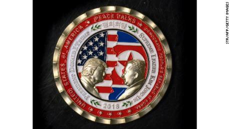 "A coin for the upcoming US-North Korea summit is seen in Washington, DC, on May 21, 2018. - A commemorative coin featuring US President Donald Trump and North Korea's Kim Jong Un has been struck by the White House Communications Agency ahead of their summit meeting. The coin depicts Trump and Kim, described as North Korea's ""Supreme Leader,"" in profile facing each other in front of a background of US and North Korean flags. The words ""Peace Talks"" are emblazoned at the top of the front of the coin with the date ""2018"" beneath. The summit is expected to take place in Singapore on June, 12, 2018. (Photo by STR / AFP)        (Photo credit should read STR/AFP/Getty Images)"