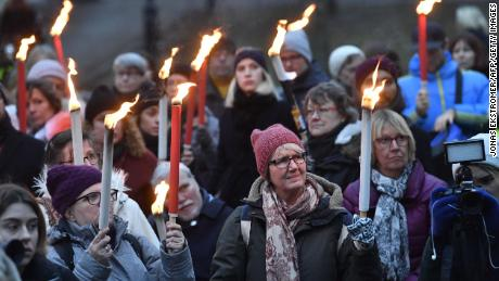People hold of torches during a rally in support of #metoo and for all victims of sexual offenses in Stockholm, Sweden on January 14, 2018, as protests were organized in various towns and cities in Sweden.  / AFP PHOTO / TT NEWS AGENCY AND TT News Agency / Jonas EKSTROMER / Sweden OUT        (Photo credit should read JONAS EKSTROMER/AFP/Getty Images)