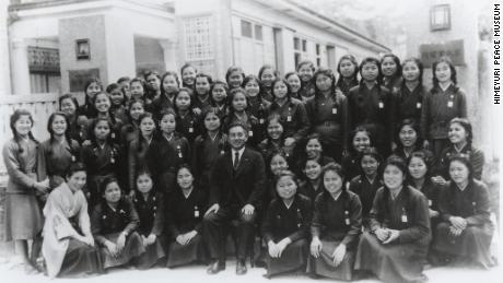 Students from the Okinawa Female Normal School with their principal Sadao Noda.
