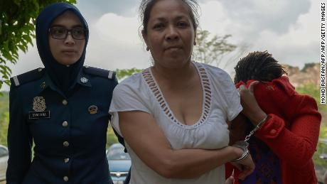 Australian national Maria Elvira Pinto Exposto (C) is escorted by a Malaysian custom official as she arrives at the Magistrate Court in Sepang on April 30, 2015. An Australian woman faces a possible death sentence for drug trafficking in Malaysia after a prosecutor said on April 30 a chemist's report confirmed the substance found in her bag was crystal methamphetamine. AFP PHOTO / MOHD RASFAN        (Photo credit should read MOHD RASFAN/AFP/Getty Images)