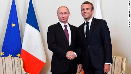 Russian President Vladimir Putin, right, shakes hands with French President Emmanuel Macron, during their meeting in St. Petersburg, Russia, Thursday, May 24, 2018. Macron's talks with Putin are set to focus on the U.S. exit from the Iranian nuclear deal, as well as conflict in Syria and Ukraine. (Kirill Kudryavtsev/Pool Photo via AP)