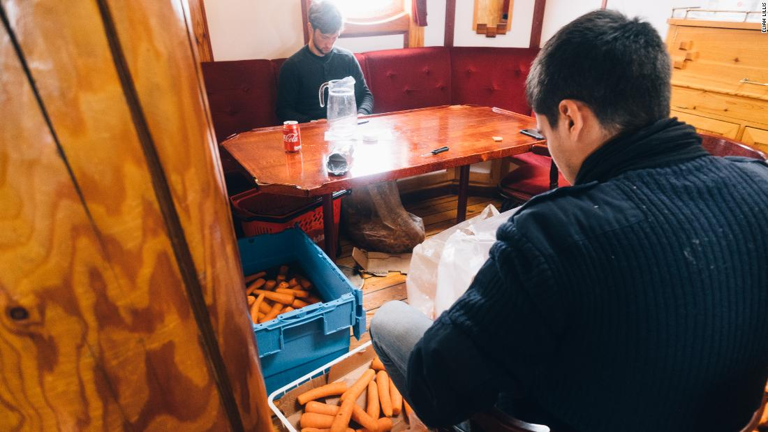 Crew peel carrots in the Linden's saloon after another outbreak of rot -- keeping food fresh on board is challenging and a learning process.