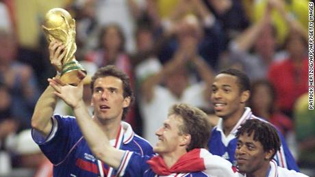 SAINT-DENIS, :  French defender Laurent Blanc (L) and captain Didier Deschamps celebrate with the FIFA Trophy 12 July at the Stade de France in Saint-Denis, near Paris, after France defeated Brazil 3-0 in the 1998 Soccer World Cup final match to win its first-ever World title. (ELECTRONIC IMAGE) AFP PHOTO PATRICK HERTZOG (Photo credit should read PATRICK HERTZOG/AFP/Getty Images)