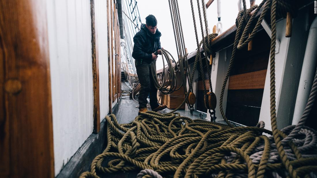 Tobias Soerensen tidies ropes on the Linden's deck during it's voyage to Svalbard.