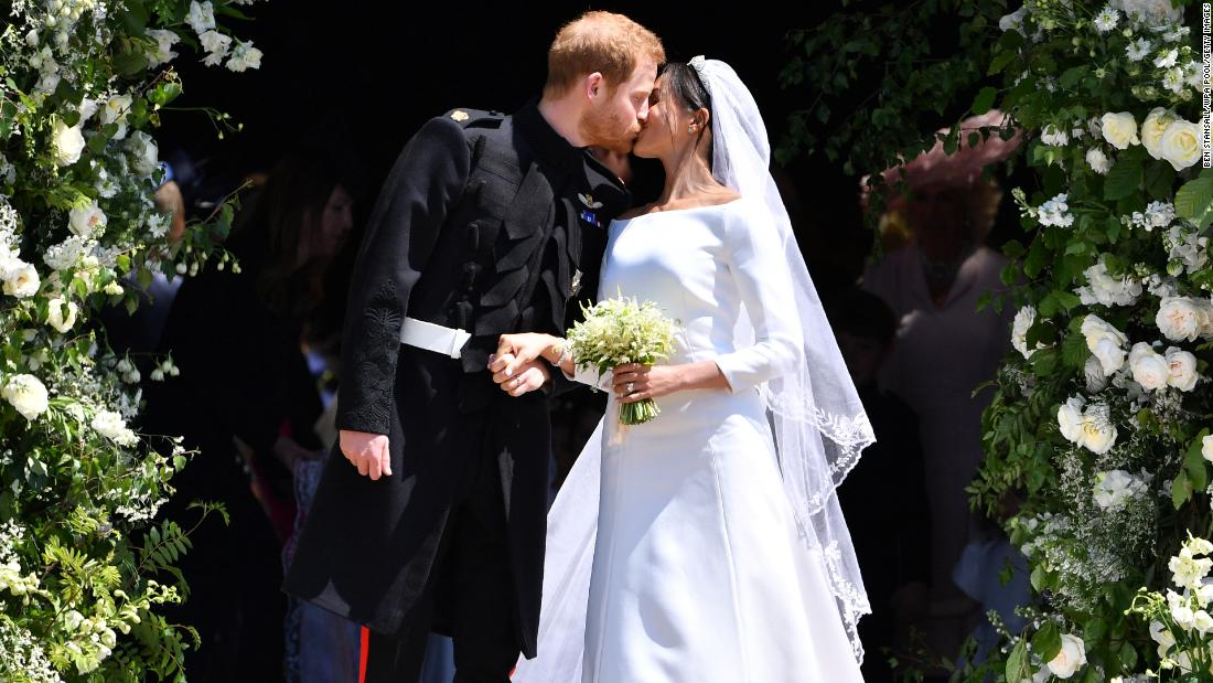 "Britain's Prince Harry and his wife, Meghan Markle, kiss on the steps of St. George's Chapel shortly after <a href=""http://www.cnn.com/interactive/2018/05/world/royal-wedding-cnnphotos/index.html"" target=""_blank"">being married</a> in Windsor, England, on Saturday, May 19. <a href=""https://www.cnn.com/interactive/2018/05/world/royal-wedding-gigapixel/"" target=""_blank"">Zoom in to this cool interactive photo from their wedding procession</a>"