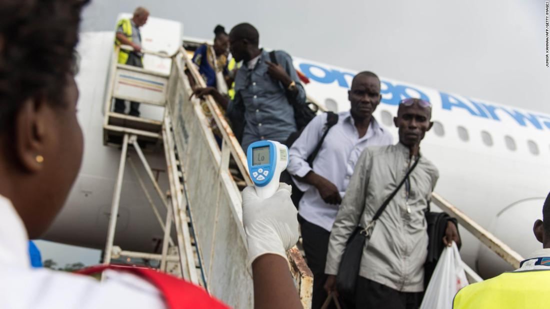"A health official uses a thermometer to take the temperature of people who just got off an airplane in Mbandaka, Congo, on Saturday, May 19. The Ebola virus has killed at least 22 people in the country since <a href=""https://www.cnn.com/2018/05/24/health/ebola-congo-outbreak-patients-escape/index.html"" target=""_blank"">an outbreak</a> started on May 8, according to the country's Ministry of Public Health."