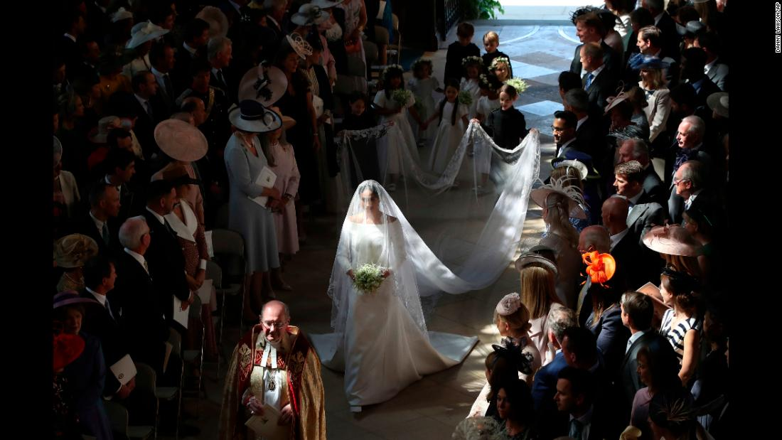"Meghan Markle walks down the aisle of St. George's Chapel as she prepares to marry Britain's Prince Harry on Saturday, May 19. She was unescorted in what was <a href=""https://www.cnn.com/europe/live-news/royal-wedding-prince-harry-meghan-markle/h_c6c6a005e5da223a0752a392b0b67411"" target=""_blank"">an unprecedented step</a> for a royal bride in the United Kingdom. Her father was unable to attend the wedding <a href=""https://www.cnn.com/2018/05/17/europe/meghan-markle-father-royal-wedding-intl/index.html"" target=""_blank"">because of health concerns. </a>"