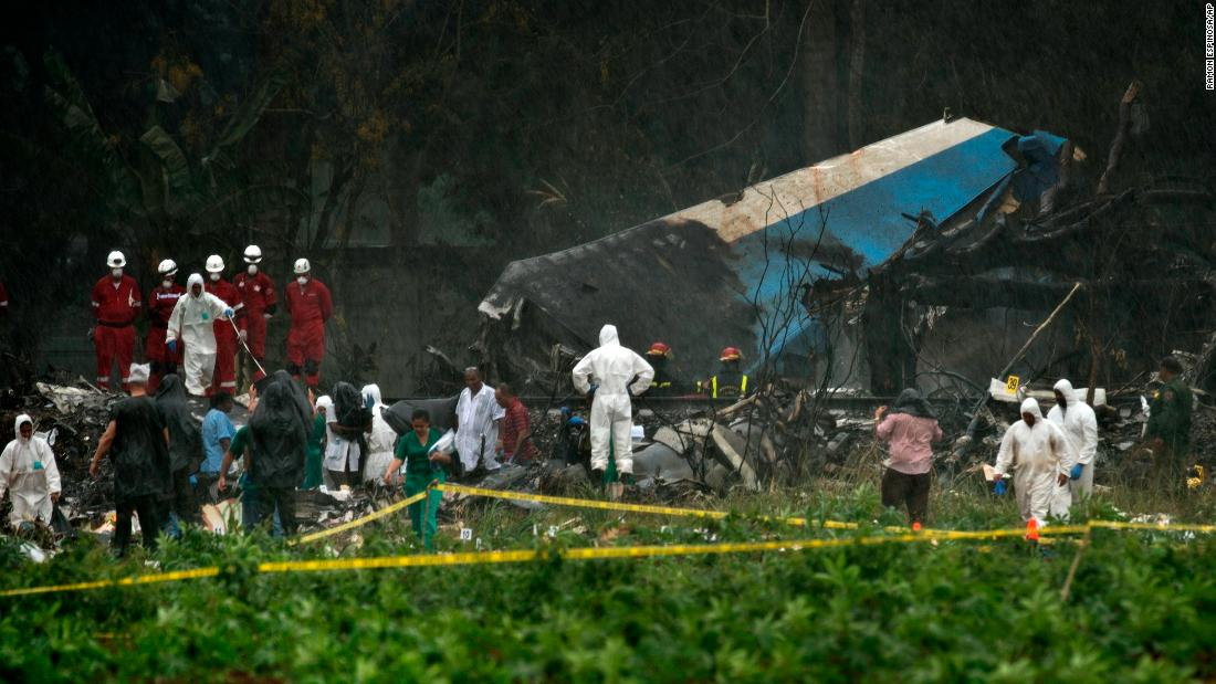 "Rescue teams search through the wreckage of <a href=""https://www.cnn.com/2018/05/18/americas/cuba-airliner-crash/index.html"" target=""_blank"">a passenger plane that crashed</a> in Havana, Cuba, on Friday, May 18.  More than 100 people were believed to be dead, state-run media reported."