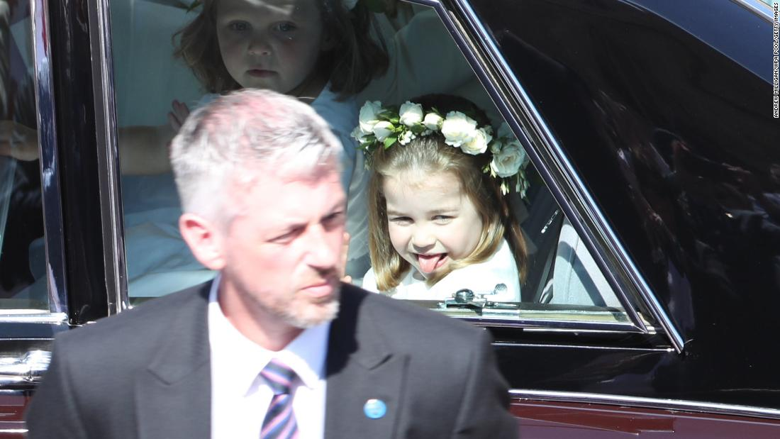 "Princess Charlotte, daughter of Britain's Prince William and Duchess Catherine, sticks her tongue out as she rides to <a href=""http://www.cnn.com/interactive/2018/05/world/royal-wedding-cnnphotos/index.html"" target=""_blank"">the wedding</a> of her uncle Harry on Saturday, May 19."