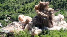 North Korea blows up tunnels at nuclear test site