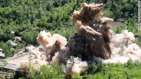 In this Thursday, May 24, 2018 photo, The fourth tunnel of North Korea's nuclear test site is blown up in Punggye-ri, North Korea. North Korean leader Kim Jong Un made good on his promise to demolish his country's nuclear test site, which was formally closed in a series of huge explosions Thursday as a group of foreign journalists looked on. (Korea Pool/Yonhap via AP)
