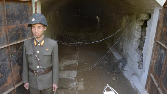A soldier stands at the entrance to tunnel 3.