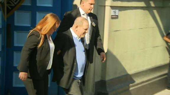 Weinstein leaves the police precinct Friday in New York.